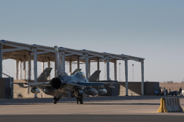 An F-16 Fighting Falcon assigned to the 134th Expeditionary Fighter Squadron taxis onto the ramp at the 407th Air Expeditionary Group, Southwest Asia, Dec. 10, 2016. The F-16 squadron is comprised of Airmen from the 158th Fighter Wing of the Vermont Air National Guard. (U.S. Air Force photo by Master Sgt. Benjamin Wilson)