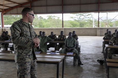 Cpl. Jeffery Street, a motor transport advisor with Special Purpose Marine Air-Ground Task Force Crisis Response-Africa, teaches soldiers with the Uganda People's Defense Force about convoy operations at Camp Singo, Uganda, Nov. 21, 2016. Marines with SPMAGTF-CR-AF taught classes and participated in practical application exercises with UPDF soldiers during the nine-week training mission. (U.S. Marine Corps photo taken by Cpl. Alexander Mitchell/released)