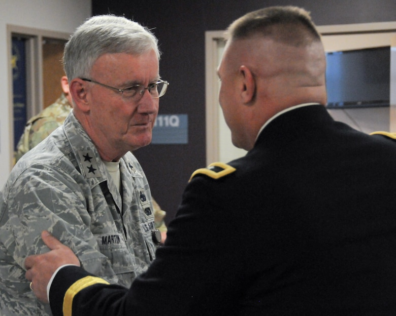 Maj. Gen. Troy D. Kok, commanding general of the Army Reserve's 99th Regional Support Command, meets with Maj. Gen. Thaddeus J. Martin, adjutant general for the Connecticut National Guard, during a capabilities briefing for federal congressional staff members Dec. 9 at the Maj. Gen. Maurice Rose Armed Forces Reserve Center in Middletown, Connecticut. Kok hosted the event in order to help the congressional members understand the Army Reserve's unique roles and capabilities, to include support to civil authorities in response to natural disasters.