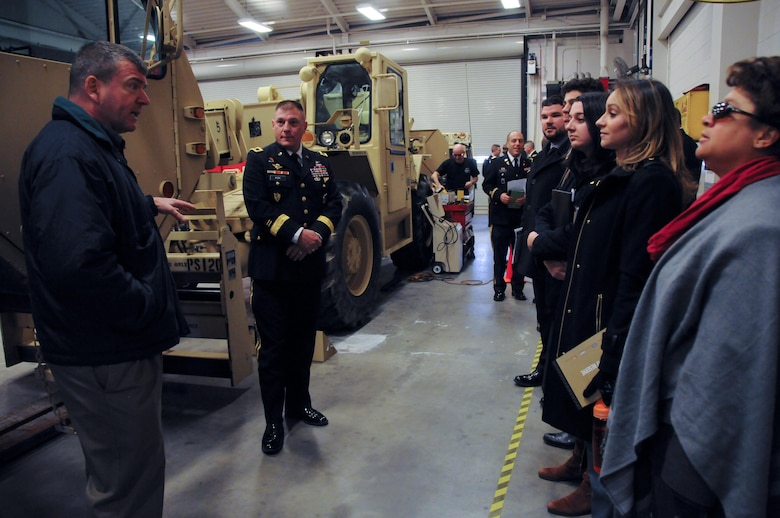 Maj. Gen. Troy D. Kok, commanding general of the Army Reserve's 99th Regional Support Command, tours an Army Reserve maintenance facility following a capabilities briefing for federal congressional staff members Dec. 9 at the Maj. Gen. Maurice Rose Armed Forces Reserve Center in Middletown, Connecticut. Kok hosted the event in order to help the congressional members understand the Army Reserve's unique roles and capabilities, to include support to civil authorities in response to natural disasters.