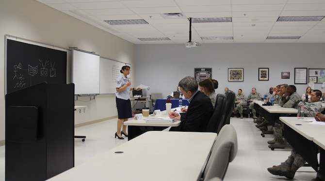 Staff Sgt. Barbara Rucker, an instructor in the United States Air Force School of Aerospace Medicine's Occupational and Environmental Health Department, presents a portion of her team's lesson to the judges at the third annual SAM-Tastic instructional excellence competition. (U.S. Air Force photo/David Snedigar)
