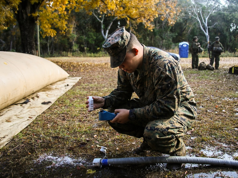 Pfc. Andrew Weaver checks the PH level of water being purified for use by the Marines of Marine Wing Support Squadron 271, Marine Aircraft Group 14, 2nd Marine Aircraft Wing, during a two-week field exercise aboard Marine Corps Auxiliary Landing Field Bogue, N.C., Nov. 30, 2016. During the two weeks, water support technicians provided enough water to the squadron's encampment for the Marines to have clean drinking water, shower facilities, laundry facilities, and cooking water. Weaver is a water support technician with MWSS-271. (U.S. Marine Corps photo by Sgt. Austin Long/ Released)