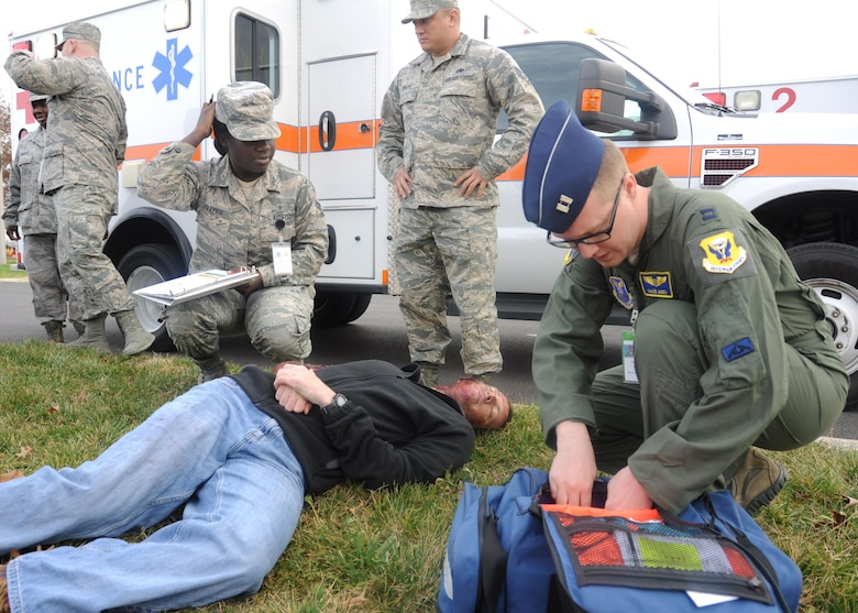 Medical personnel respond to a simulated mass casualty scenario during a total force exercise at Whiteman Air Force Base, Mo., Dec. 3, 2016. Volunteers were given different roles to simulate the varying degree of victims' temperaments and injuries. (U.S. Air Force photo/Senior Airman Missy Sterling)