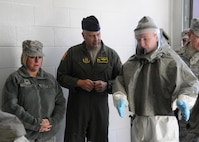 U.S. Air Force Col. Christine Kress, 509th Medical Group commander, left, and Col. Brian Borgen, 442nd Fighter Wing commander talk with Senior Airman Jerrod Sherrill, an aerospace medical technician with the 509th Medical Operations Squadron, about the decontamination process during a total force mass casualty exercise at Whiteman Air Force Base, Mo., Dec. 3, 2016. Whiteman leadership discussed the benefits of reservists, guardsmen and active-duty Airmen training side-by-side to improve interoperability and communication. (U.S. Air Force photo/Senior Airman Missy Sterling)