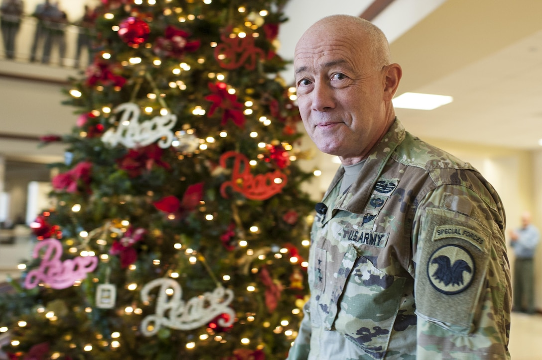 LTG Charles D. Luckey, Chief, U.S. Army Reserve and Commanding General, U.S. Army Reserve Command, smiles after lighting the Christmas tree during the USARC Holiday Open House and Tree Lighting ceremony, Dec. 9, 2016. USARC Soldiers and civilians took time out to celebrate the season and fellowship with each other. (U.S. Army photo by Timothy L. Hale/Released)