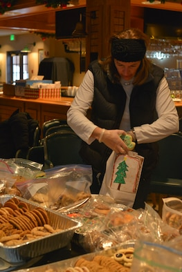 Deb Brooks, spouse of Col. Matthew Brooks 5th Bomb Wing commander, places cookies