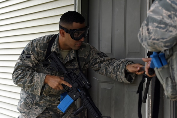 Senior Airman Xavier Graciana, a security forces specialist with the 180th Fighter Wing in Swanton, Ohio, prepares to breach a house during urban combat training Oct. 1, 2016, at the Maumee Police and Fire Training Center in Maumee, Ohio. Security Forces personnel conduct multiple annual training scenarios to maintain a high state of preparedness and readiness in the event of an emergency.
