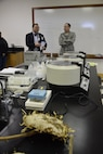 Air Force Sustainment Center Commander Lt. Gen. Lee K. Levy II, right, talks with Oklahoma School of Science and Mathematics President Dr. Frank Y.H. Wang in a science laboratory inside the Dr. Edna McDuffie Manning Academic Center Dec. 1. In the foreground is the head of a massive sunflower seed used for instruction in the natural sciences lab. General Levy learned about the school's programs while personally engaging the students to foster better understanding of the opportunities for STEM careers in AFSC and the Air Force. (U.S. Air Force photo/Greg L. Davis)