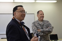 Oklahoma School of Science and Mathematics President Dr. Frank Y.H. Wang, left, discusses amenities of a science laboratory inside the Dr. Edna McDuffie Manning Academic Center with Air Force Sustainment Center Commander Lt. Gen. Lee K. Levy II during a tour of the school Dec. 1. General Levy learned about the school's programs while personally engaging the students to foster better understanding of the opportunities for STEM careers in AFSC and the Air Force. (U.S. Air Force photo/Greg L. Davis)
