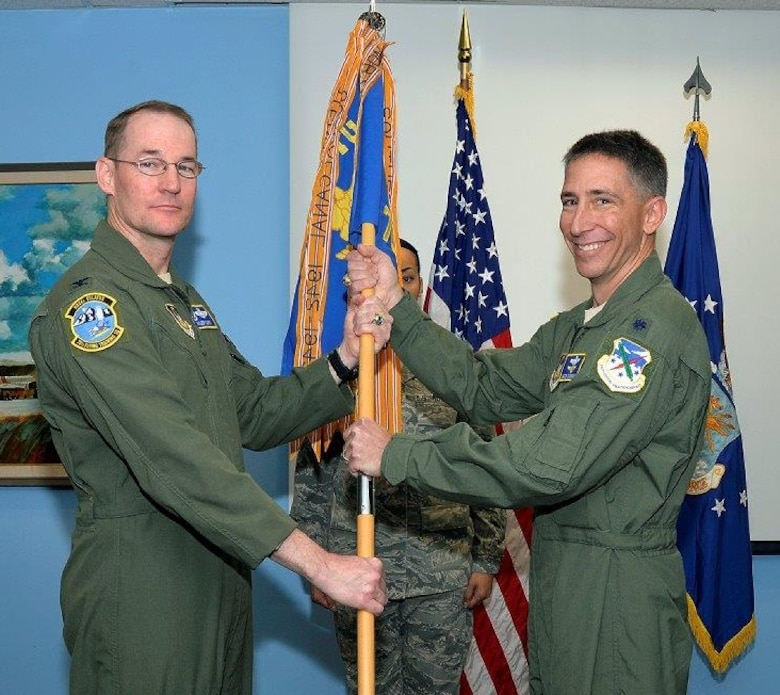 Lt. Col. Jason Cashman (right) accepts the 70 FTS guidon from Col. Roger Suro, Commander of the 340th Flying Training Group, Joint Base San Antonio-Randolph-Texas during the Change of Command Ceremony Dec. 1 at the U.S. Air Force Academy. These ceremonies represent the formal passing of responsibility, authority and accountability of command from one officer to another. (U.S. Air Force photo).