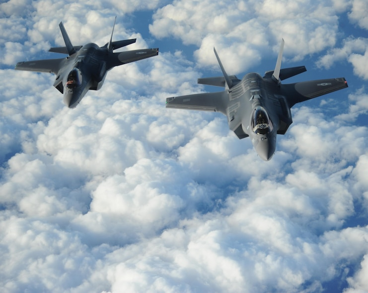 "Two Israeli F-35 ""Adirs"" fly in formation and display the U.S. and Israeli flags after receiving fuel from a Tennessee Air National Guard KC-135, Dec, 6, 2016. The U.S. and Israel have a military relationship built on trust developed through decades of cooperation. (U.S. Air Force photo by 1st Lt. Erik D. Anthony)"