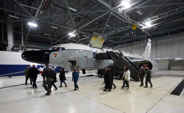 Spouses associated with the 55th Wing get a static tour of an RC-135 Aircraft parked in a hangar of the Bennie Davis Maintenance Facility as part of Spouse Appreciation Night, Dec. 7, 2016, at Offutt Air Force Base, Neb. Spouses of both officers and enlisted Airmen from various squadron participated in the first appreciation night.  Future tours are already being slated for future dates. (U.S. Air Force photo by Josh Plueger)