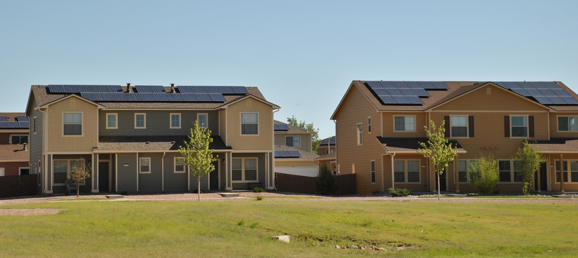 Duplex housing at Peterson Air Force Base, Colorado, features rooftop solar panels. The homes are part of the Air Force Housing Privatization program portfolio, which is managed by the Air Force Civil Engineer Center. (U.S. Air Force photo/Carole Chiles Fuller)