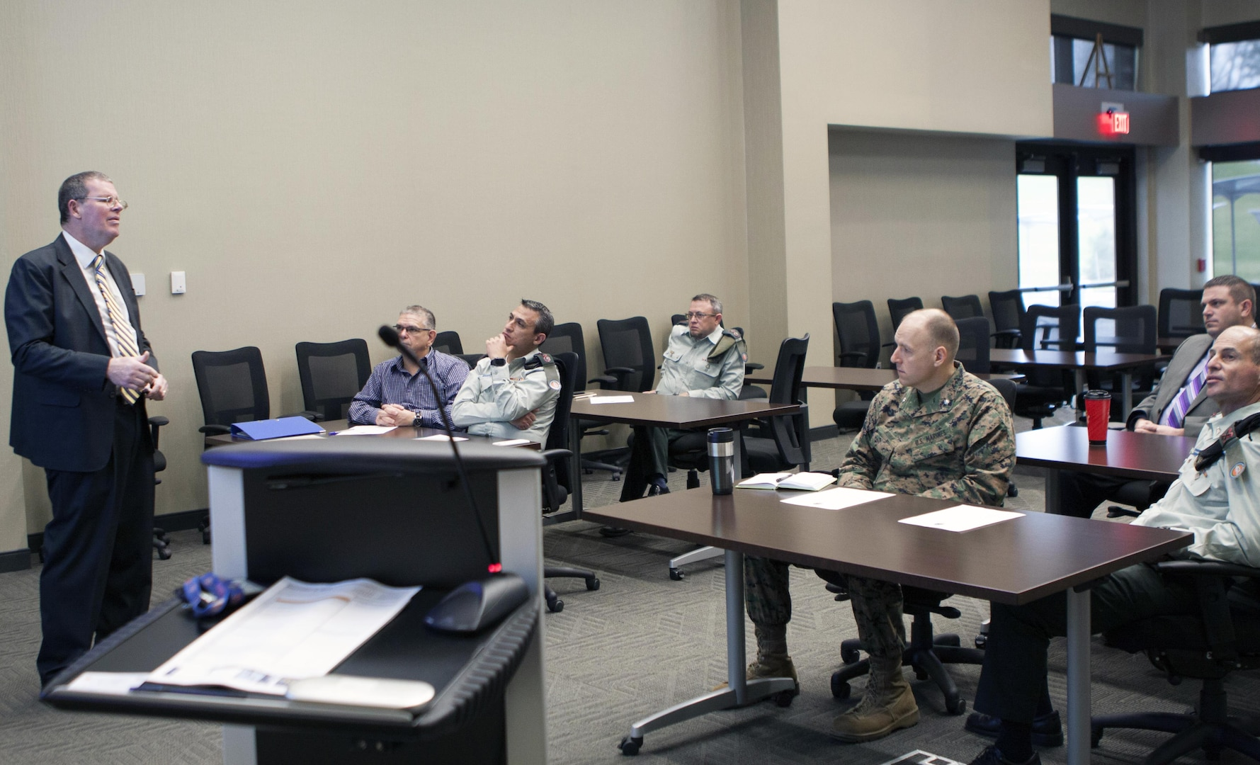 Scott Rosbaugh, director of DLA Distribution's Strategic Plans directorate, discusses DLA Distribution's core capabilities with members of the Israel Defense Forces on December 6.