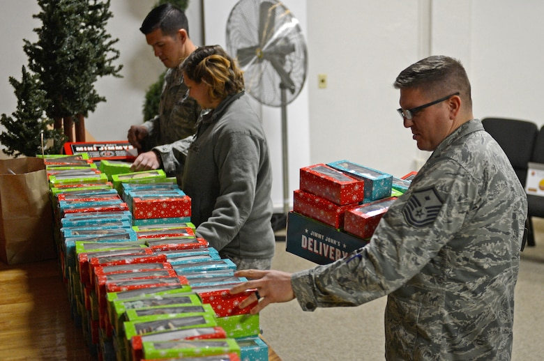 Master Sgt. Matthew Shaver, 627th Civil Engineer Squadron first sergeant, prepares to deliver cookies during Operation Cookie Drop Dec. 9, 2016 at McChord Field, Wash. Shaver along with other McChord First Sergeants delivered more the 500 boxes of cookies to Airmen in the dorms in effort to spread holiday cheer. (U.S. Air Force photo/Senior Airman Divine Cox)