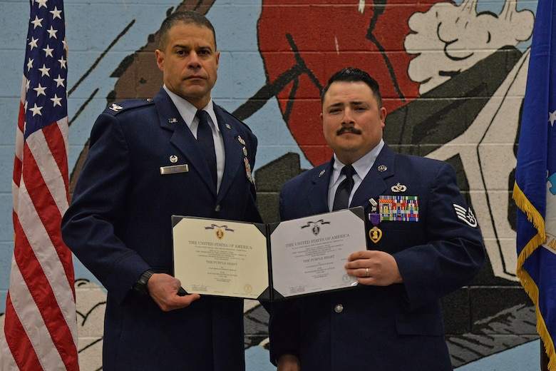 Col. Jose Rivera, 819th RED HORSE Squadron commander, left, and Staff Sgt. Joseph Dickison, 819th RHS heating, ventilation and air conditioning technician, pose for a photo at a Purple Heart medal ceremony Dec. 9, 2016, at Malmstrom Air Force Base, Mont. Dickison was awarded the Purple Heart for combat wounds received in Afghanistan in July 2009. (U.S. Air Force photo/Airman 1st Class Daniel Brosam)