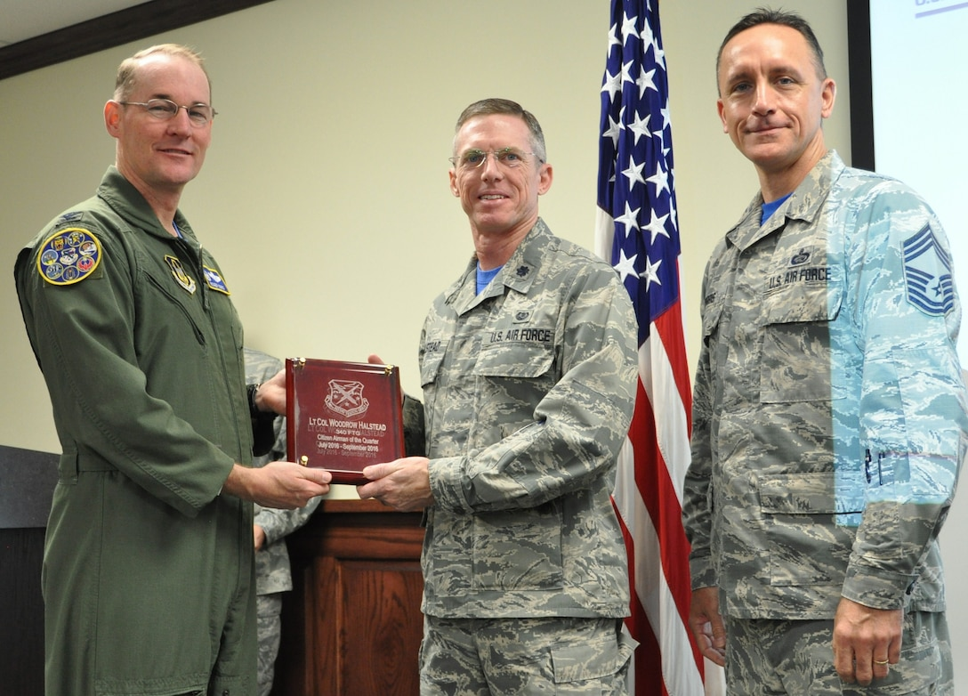 Col Roger Suro, 340th FTG commander (L),  and Chief Master Sgt. Jimmie Morris present Lt. Col. Woodrow Halstead (center) with the award for citizen airman of the quarter, third quarter during the Group's MUTA held Dec. 1-2 at Joint Base San Antonio-Randolph, Texas (Photo by Janis El Shabazz).