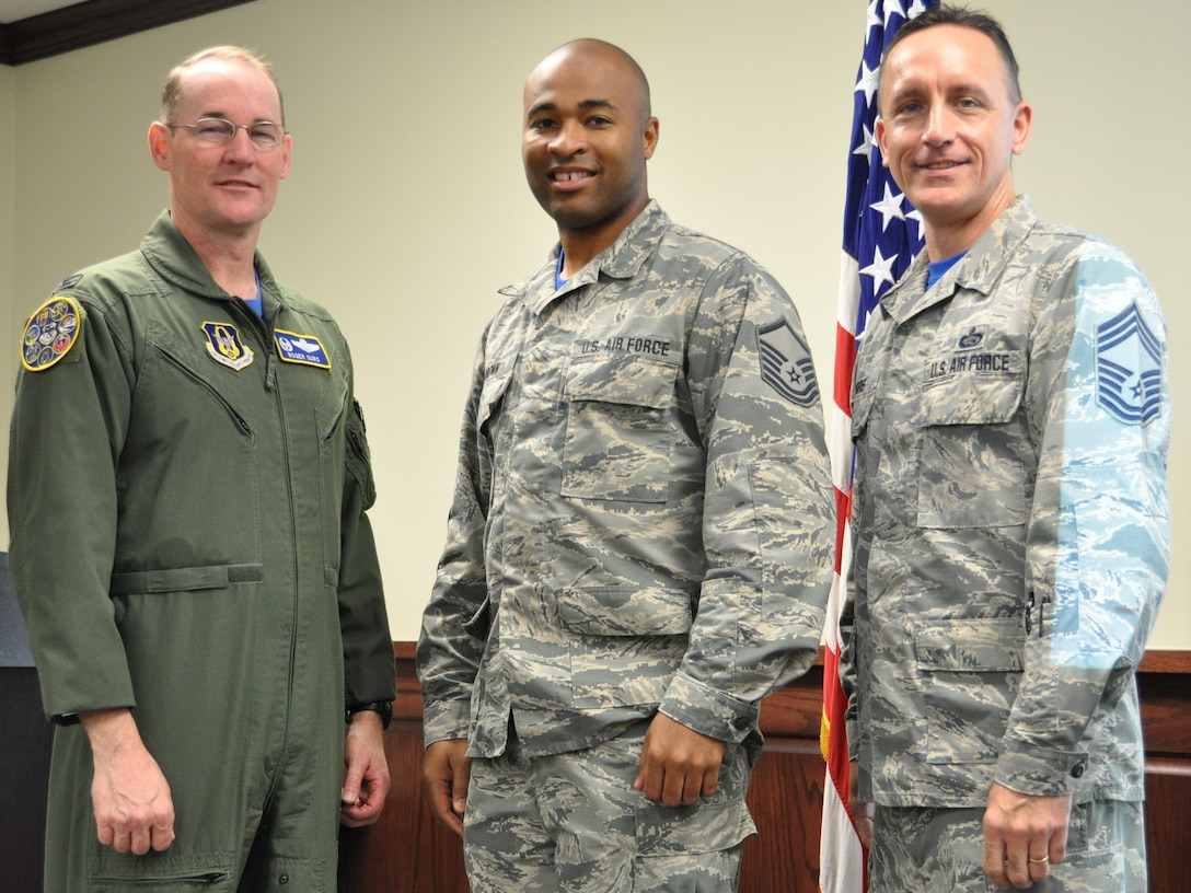 Master Sgt. Gregory Brown stands with 340th FTG commander, Col. Roger Suro (L) and Chief Master Sgt. Jimmie Morris, group superintendent to receive a Joint Service Achievement Medal during the Group's MUTA held Dec. 1-2 at Joint Base San Antonio-Randolph, Texas (Photo by Janis El Shabazz).