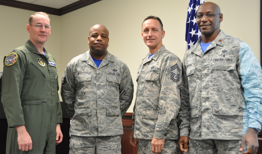 Master Sgt. Derrick Worthy (2nd from left) Stands with Col. Roger Suro, 340th FTG commander, Maj. Thallas Lumpkin, 340th FTG comptroller and group superintendent, Chief Master Sgt. Jimmie Morris during the group's Dec. 1 MUTA at Joint Base San Antonio-Randolph, Texas  to commemorate his  receipt of Department of Defense certification in financial management during the group's Dec. 1 MUTA at Joint Base San Antonio-Randolph, Texas (Photo by Janis El Shabazz).