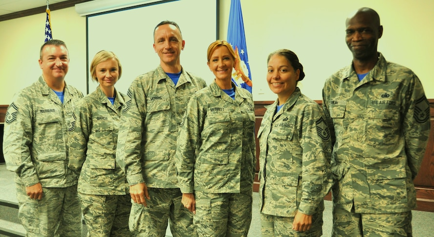Chief Master Sgt. Jimmie Morris, 340th FTG  group superintendent (center) stands with Senior Master Sgts. (L to R) Jon Rousseaux, Laura Garcia, Laura Merritt, Michele Cartagena and Kwame Tawiah during the Group's MUTA held Dec. 1-2 at Joint Base San Antonio-Randolph, Texas as 340 FTG commander, Col. Roger Suro recognizes them for the leadership and mentorship they provide to the junior enlisted Airmen (Photo by Janis El Shabazz).