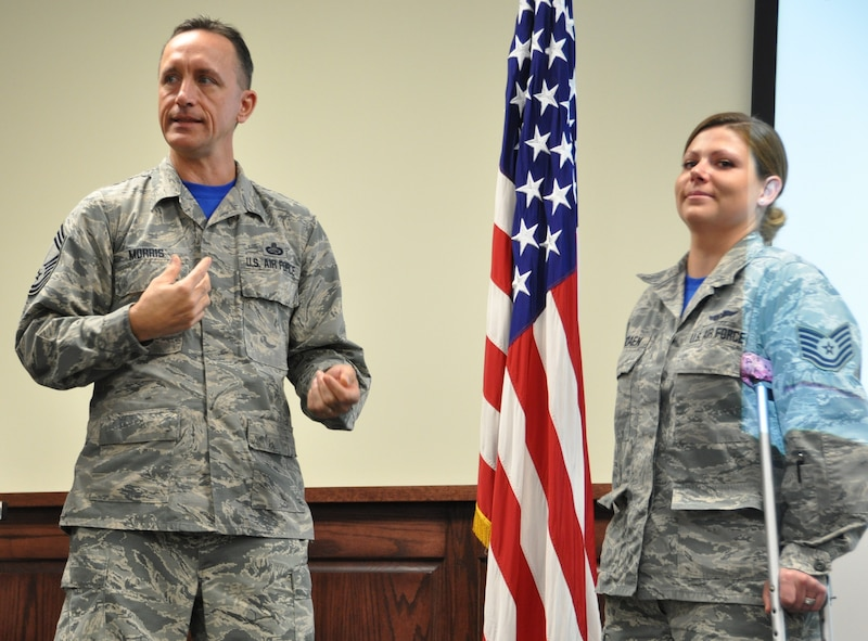 Tech. Sgt. Corrin receives recognition and congratulations for the work she did to organize and manage the events  for the Air Force Reserve Command's Senior NCO Leadership Development Course held here Nov. 4-5 (Photo by Janis El Shabazz).