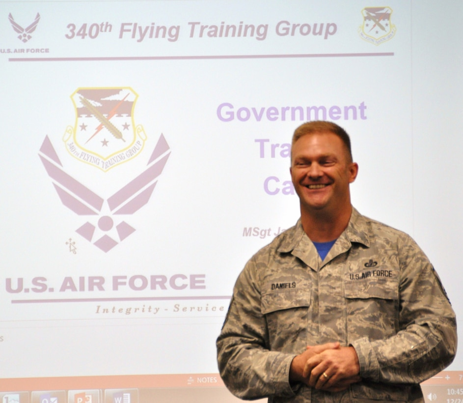 Master Sgt. Jason Daniels presents a brief on the government travel card during the 340th Flying Training Group's MUTA held Dec. 1-2  at Joint Base San Antonio-Randolph, Texas (Photo by Janis El Shabazz).