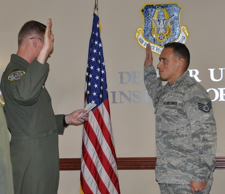 Staff Sgt.  Brett Daniel being promoted to Tech. Sgt. by Col. Roger Suro, 340th FTG commander at the Group's MUTA held Dec. 1-2 at Joint Base San Antonio-Randolph, Texas (Photo by Janis El Shabazz).