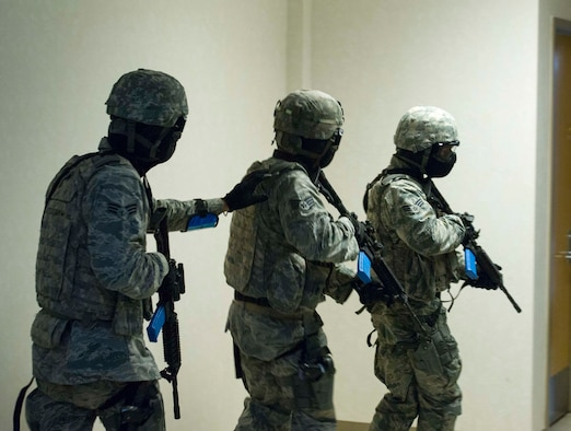 The 446th Security Forces Squadron trains to enter a building during an Active Shooter exercise at Joint Base Lewis-McChord, Dec. 3. Among the most vital purposes of the exercise was to validate the efficacy of the Shoot Move Communicate training to include the use of reasonable force. During the exercise Quick Response Forces reacted and had to make split-second decisions about the level of force that was necessary to engage in. (U.S. Air Force Reserve photo by Staff Sgt. Daniel Liddicoet)