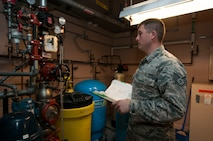 Staff Sgt. Benjamin Cestoni, 320th Missile Squadron facility manager, inspects the missile alert facility water pressure system in the F.E. Warren missile complex in Wyoming, Nov. 5, 2016. FMs are charged with ensuring the missile alert facility functions properly by performing daily inspections on the various systems and restocking items like linen and food. (U.S. Air Force photo by Staff Sgt. Christopher Ruano)