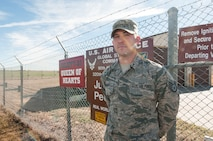 Staff Sgt. Benjamin Cestoni, 320th Missile Squadron facility manager, stands in front of a missile alert facility in the F.E. Warren missile complex in Wyoming, Nov. 5, 2016. The FM position is a four year special duty tour that is open to staff sergeant selects through master sergeant. (U.S. Air Force photo by Staff Sgt. Christopher Ruano)