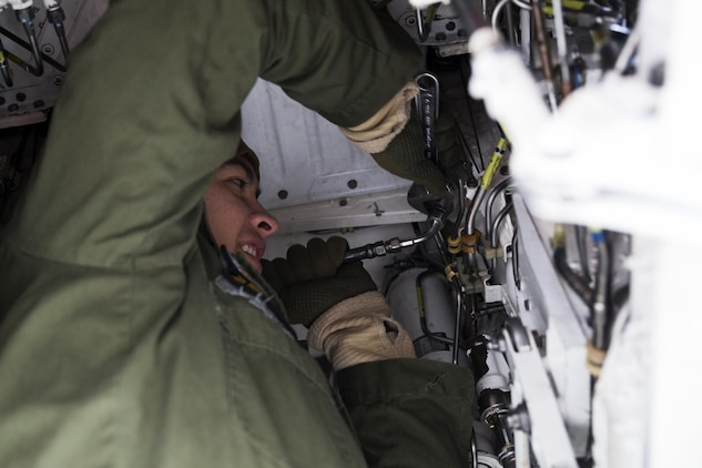 U.S. Marine Corps Lance Cpl. Anthony Dominguez, an air framer with Marine Attack Squadron (VMA) 542, works on an AV-8B Harrier during the Aviation Training Relocation Program at Chitose Air Base, Japan, Dec. 7, 2016. Keeping the Harriers well maintained and ensuring the proper function of all systems is essential to supporting the ATR. (U.S. Marine Corps photo by Lance Cpl. Joseph Abrego)