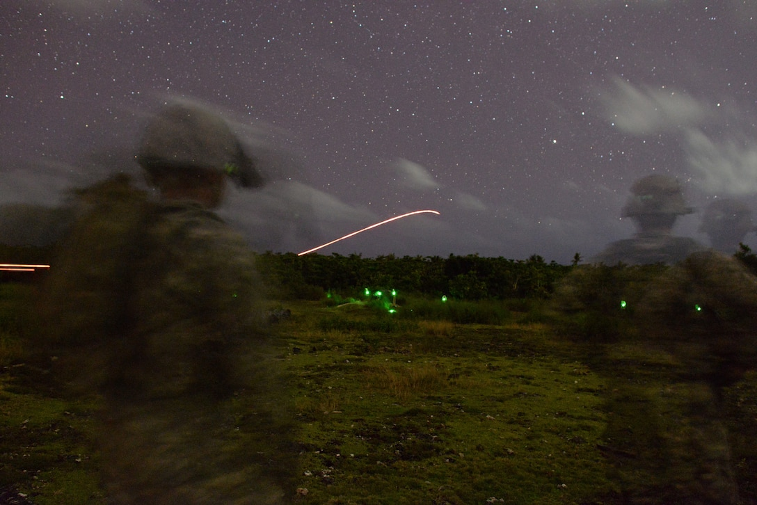 A U.S. Army squad from Alpha Company, 4th Battalion, 23rd Infantry Regiment, 2nd Stryker Brigade Combat Team, 2nd Infantry Division eliminates simulated targets during a night time squad live-fire exercise Nov. 18, 2016, at Andersen Air Force Base, Guam. After executing their objective during daylight hours, squads repeated the scenario using infrared lasers to mark their targets in the dark to gain experience working in low-light situations. (U.S. Air Force photo by Airman 1st Class Jacob Skovo)