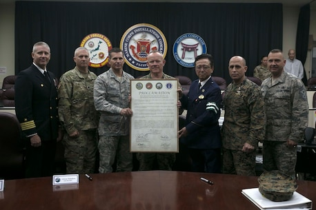 Senior leaders from the Okinawa Police Department and U.S. Forces Japan pose with the 2016 Drugged and Drunk Driving Proclamation Dec 6, 2016 aboard Camp Foster, Okinawa, Japan. The proclamation signifies the start of a safety and awareness program designed to reduce the number of alcohol and drug-related automobile incidents on Okinawa. According to Lt. Gen. Larry Nicholson, the Okinawa Area Coordinator, although the number of drugged and drunk driving incidents is down from last year, it is important that safety and responsibility continue to be instilled in all service members.