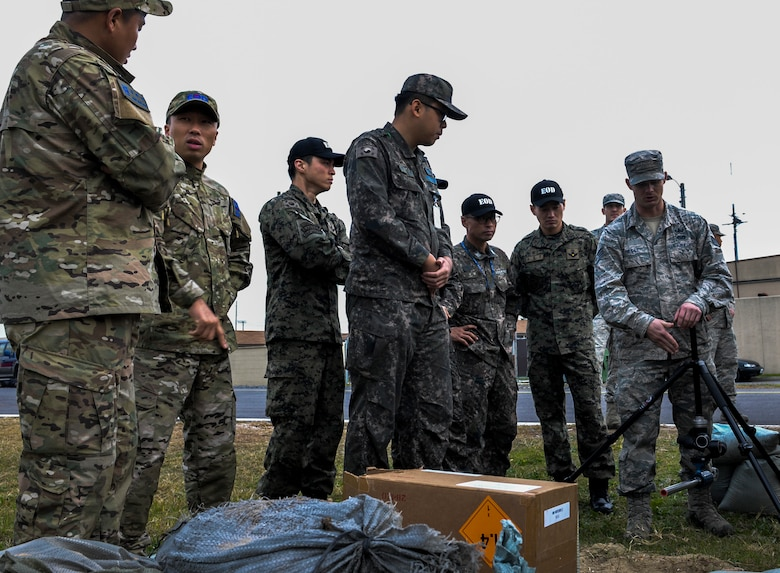 U.S. Air Force Staff Sgt. William Riddle, 8th Civil Engineer Squadron explosive ordnance disposal technician, teaches different ways of disposing ordnance to Republic of Korea Air Force EOD members at Kunsan Air Base, Republic of Korea, Nov. 7, 2016. This training increases U.S. and ROK interoperability and ultimately enhances U.S. and ROK commitments to maintain peace in the region. (U.S. Air Force photo by Senior Airman Colville McFee/Released)