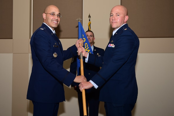 Maj. Christopher Humphrey, 460th Comptroller Squadron commander, assumes command Dec. 12, 2016, during the 460th CPTS change of command ceremony on Buckley Air Force Base, Colo. A change of command ceremony represents the formal transfer of responsibility from an outgoing commander to their successor. (U.S. Air Force photo by Airman Jacob Deatherage/Released)