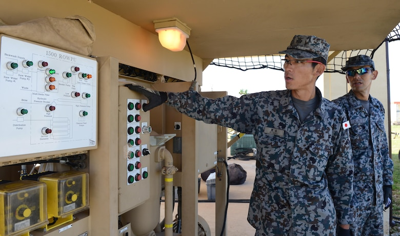 Airmen with the Japan Air Self-Defense Force operate a reverse osmosis water purification unit during Silver Flag Dec. 6, 2016, at Northwest Field, Guam. Silver Flag is a U.S. Pacific Command multilateral subject matter expert exchange led by engineers from the 554th RED HORSE Squadron. The exercise is designed to build partnerships and promote interoperability through the equitable exchange of civil engineer-related information. (U.S. Air Force photo by Senior Airman Arielle K. Vasquez/Released)