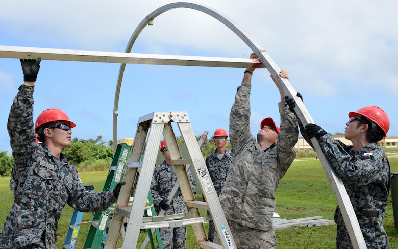 U.S. Air Force and Japan Air Self-Defense Force Airmen assemble frames during Silver Flag Dec. 5, 2016, at Northwest Field, Guam. U.S. Pacific Command's partner nation Silver Flag training classes are held to promote mutual understanding between partner nations and PACAF civil engineers' missions, capabilities and objectives. (U.S. Air Force photo by Senior Airman Arielle K. Vasquez/Released)