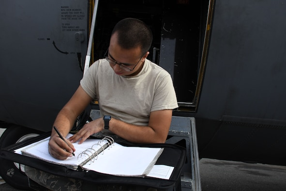 Airman 1st Class Jaime Gurrola, a 386th Expeditionary Aircraft Maintenance Squadron aerospace maintenance journeyman, prepares required forms for tire removal Dec. 5, 2016 at an undisclosed location in Southwest Asia. The aerospace maintainers installed new tires on an EC-130H Compass Call as part of preventive maintenance. (U.S. Air Force photo/Senior Airman Andrew Park)