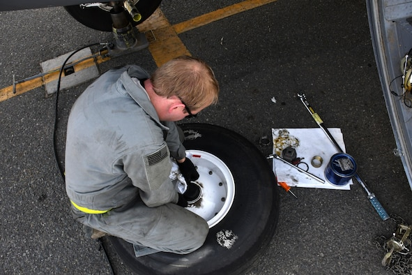Staff Sgt. Sean Jones, a 386th Expeditionary Aircraft Maintenance Squadron aerospace maintenance craftsman, reassembles a wheel after removing it from an EC-130H Compass Call Dec. 5, 2016 at an undisclosed location in Southwest Asia. The wheel and tire must be reassembled before shipping it off to the wheel and tire back shop. (U.S. Air Force photo/Senior Airman Andrew Park)