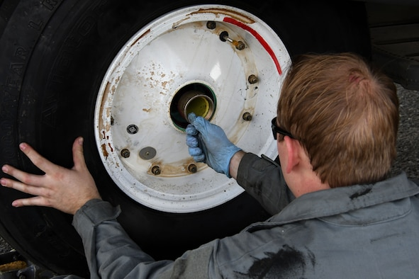 Staff Sgt. Sean Jones, a 386th Expeditionary Aircraft Maintenance Squadron aerospace maintenance craftsman, secures a wheel to the axle of an EC-130H Compass Call Dec. 5, 2016 at an undisclosed location in Southwest Asia. The EC-130s are regularly moved between the 386th and Davis-Monthan Air Force Base. (U.S. Air Force photo/Senior Airman Andrew Park)