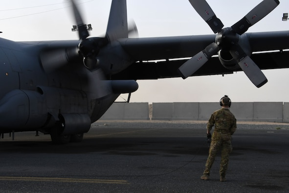 A 386th Expeditionary Operations Group airborne maintenance technician monitors an EC-130H Compass Call as it starts its engines on Dec. 5, 2016 at an undisclosed location in Southwest Asia. The Compass Call is engaged in operations jamming Da'esh communications in order to confuse and disorient enemy fighters. (U.S. Air Force photo/Senior Airman Andrew Park)