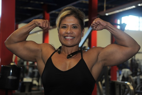 Maria Flores, a retired U.S. Army sergeant first class, poses for a photo after a workout at MacDill Air Force Base, Fla., Dec. 8, 2016. Flores, a 56-year-old bodybuilder, is training for competitions coming up in 2017. (U.S. Air Force photo by Airman 1st Class Adam R. Shanks)