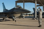 An crew chief with the 407th Expeditionary Aircraft Maintenance Squadron marshals an F-16 Fighting Falcon pilot with the 134th Expeditionary Fighter Squadron onto the ramp after arriving at the 407th Air Expeditionary Group, Southwest Asia, Dec. 10, 2016. About 300 Airmen from the 158th Fighter Wing of the Vermont Air National Guard arrived in the past few days to support the F-16 mission here. (U.S. Air Force photo by Master Sgt. Benjamin Wilson)(Released)