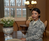 Staff Sgt. Isata Tucker, a manager on duty at the Fisher House for Families of the Fallen, Dover Air Force Base, Del., manages the facility on Dec. 12, 2016, ensuring that the property is always ready for use. Staff Sgt. Tucker survived a war in her former country of Sierra Leone, Africa. She recieved her U.S. citizenship on the same day she graduated from Air Force Basic Military Training in 2013.