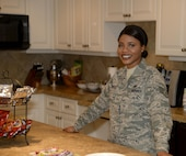 Staff Sgt. Isata Tucker, a manager on duty at the Fisher House for Families of the Fallen, on Dover Air Force Base, Del., manages the facility on Dec. 12, 2016, ensuring that the property is always ready for use. Staff Sgt. Tucker survived a war in her former country of Sierra Leone, Africa. She recieved her U.S. citizenship on the same day she graduated from Air Force Basic Military Training in 2013.