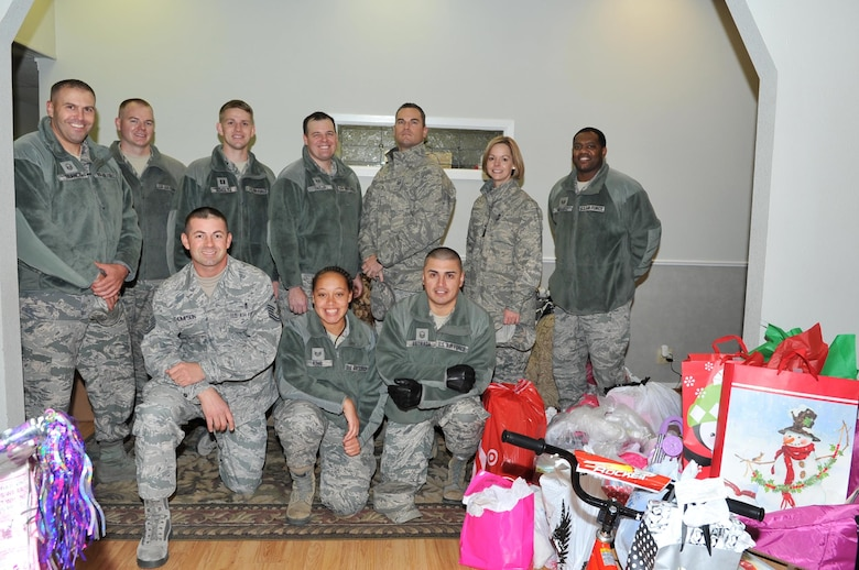 Goodfellow Air Force Base members after delivering toys to the Court Appointed Special Advocates for Children center, San Angelo, Texas, Dec. 8, 2016. Goodfellow members provided gifts for 340 children in emergency foster care. (U.S. Air Force photo by Staff Sgt. Laura R. McFarlane/Released)