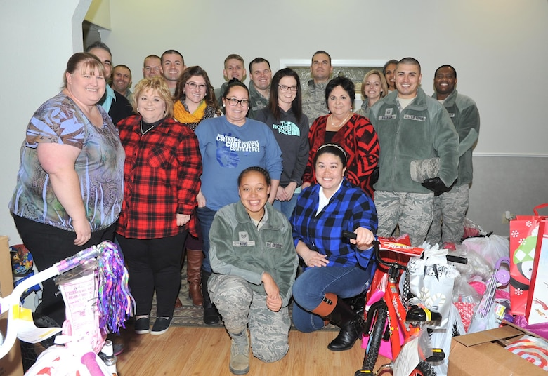 Goodfellow Air Force Base members and Court Appointed Special Advocates for Children center employees at the CASA center, San Angelo, Texas, Dec. 8, 2016. Goodfellow members provided gifts for 340 children in emergency foster care. (U.S. Air Force photo by Staff Sgt. Laura R. McFarlane/Released)
