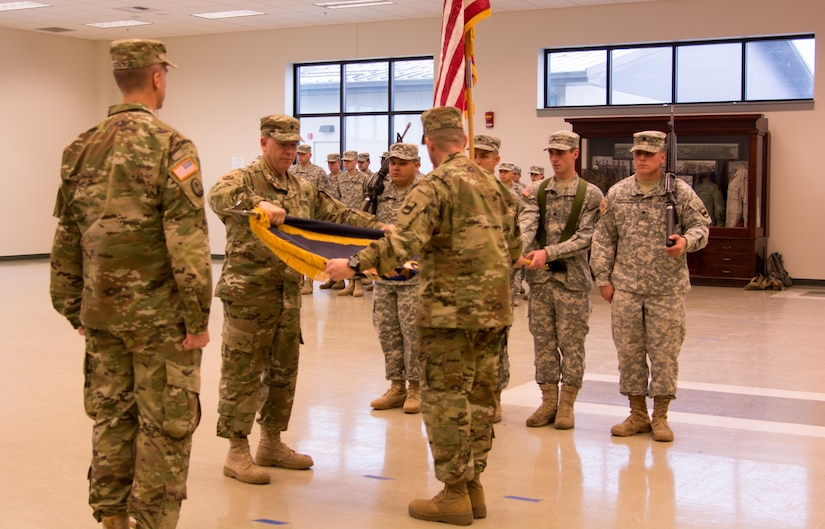VANCOUVER, Wash. - The 1st Battalion of the 413th Regiment Commander, Lt. Col. Kenneth Beseau (left) and Command Sgt. Maj. Joseph Garcia (right) furl the flag as the Commander of the 800th Logistics Support Brigade, Col. Bradly Boganowski, (center) awaits to receive the encased flag during the unit's deactivation ceremony held here on Dec. 9, 2016. The ceremony marks the closing of the unit as part of a larger restructuring of the 800th Logistics Support Brigade, headquartered in Mustang, Oklahoma.