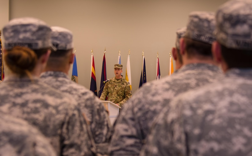 """VANCOUVER, Wash. – The Commander of the 800th Logistics Support Brigade, Col. Bradly Boganowski, shares his thoughts during the 1st Battalion of the 413th Regiment's deactivation ceremony held here on Dec. 9, 2016. """"I couldn't be prouder in you or your service to this battalion and the 800th brigade,"""" said Boganowski. """"Now, I charge you to carry the spirit of the 1st Battalion 413th Regiment forward."""" The ceremony marks the closing of the unit as part of a larger restructuring of the 800th Logistics Support Brigade, headquartered in Mustang, Oklahoma."""