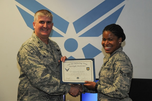 Airman 1st Class Christina Reddie, 22nd Logistics Readiness Squadron vehicle operator, poses with Col. Albert Miller, 22nd Air Refueling Wing commander, Dec. 12, 2016, at McConnell Air Force Base, Kan. Reddie received the spotlight performer for the week of Nov. 28- Dec. 2. (U.S. Air Force photo/Airman 1st Class Jenna K. Caldwell)